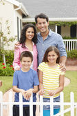Hispanic family outside home — Foto de Stock