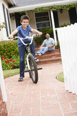 Boy and grandfather at home with bike — Stockfoto