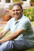 Mid age man relaxing in garden — Stock Photo