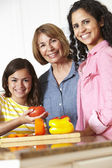 Mother,daughter and grandmother cooking — Stock Photo