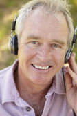 Senior man with headphone — Stock Photo