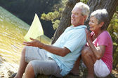 Senior couple fishing together — Stock Photo
