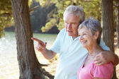 Senior couple at lake together — Stock Photo