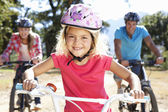 Young family on country bike ride — Stock Photo