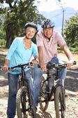 Senior couple on country bike ride — Stock Photo