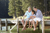 Father,son and grandson fishing together — Stock Photo