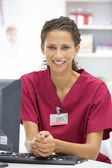 Young hospital doctor at desk — Stock Photo