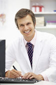 Hospital doctor at desk — Stock Photo