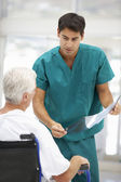 Senior patient with young doctor — Stock Photo