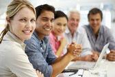 Grupo mixto en la reunión de negocios — Foto de Stock