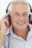 Senior man with headphones — Stock Photo