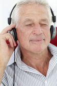 Senior man with headphones — Stock Photo