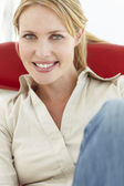 Woman sitting in chair — Stock Photo