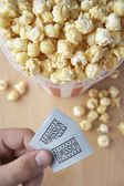 Popcorn and cinema tickets — Stock Photo