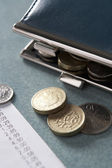 Open purse with till receipt and coins — Stock Photo