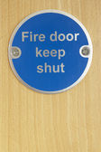 Keep shut sign on fire door — Stock Photo