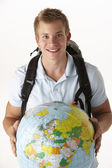 Young traveller with globe — Stock Photo