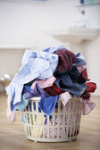 Basket of dirty washing in bathroom — Stock Photo
