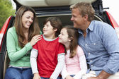 Family outdoors with car — Foto Stock