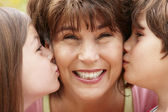 Hispanic grandmother and grandchildren — Stock Photo