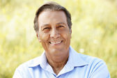 Portrait senior Hispanic man outdoors — Stock Photo