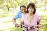 Senior Hispanic couple with bike — Stock Photo
