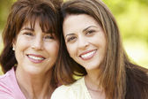 Portrait Hispanic mother and adult daughter — Foto Stock