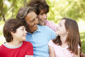 Hispanic grandparents and grandchildren outdoors — Stock Photo