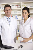 American pharmacists at work — Stock Photo