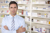 Portrait UK pharmacist at work — Stock Photo