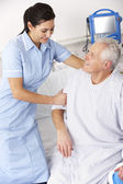 Nurse helping male patient in UK Accident and Emergency — Stock Photo