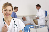 American doctor and team on hospital ward — Stock Photo