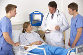 American medical team by patient's bed — Stock Photo