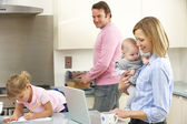 Family busy together in kitchen — Stock Photo
