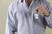Cropped Shot Of Man Holding Keys To First Home — Stock Photo