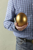 Cropped Studio Shot Of Man Holding Golden Egg — Stock Photo