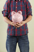 Cropped Studio Shot Of Young Boy Holding Pink Piggy Bank — Stock Photo