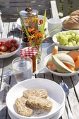 Outdoor table set for breakfast — Stock Photo