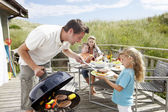Family on vacation having barbecue — Stok fotoğraf