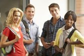 Mixed group of students in college — Stock Photo