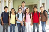 Pre teen schoolchildren with teacher — Stock Photo