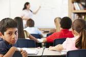 Unhappy schoolboy in class — Stock Photo