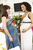 Pregnant women out shopping — Stock Photo