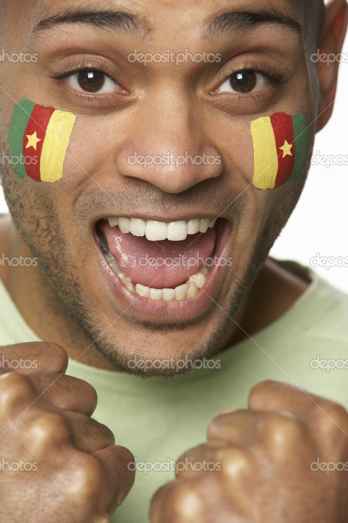Young Male Sports Fan With Cameroon Flag Painted On Face — Stock Photo #11880621