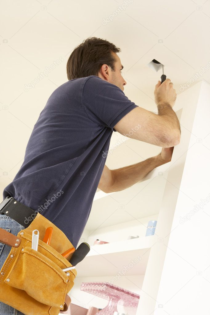 Electrician Installing Light Fitting In Home — Stock Photo #11880690