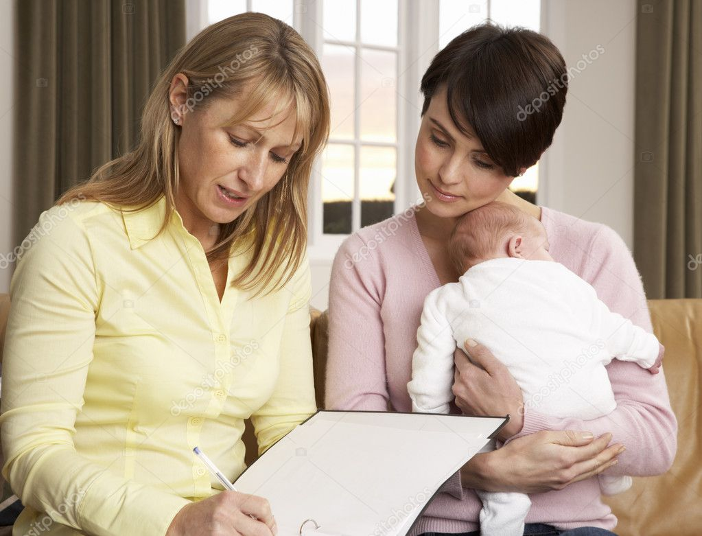Mother With Newborn Baby Talking With Health Visitor At Home  Stock Photo #11881513