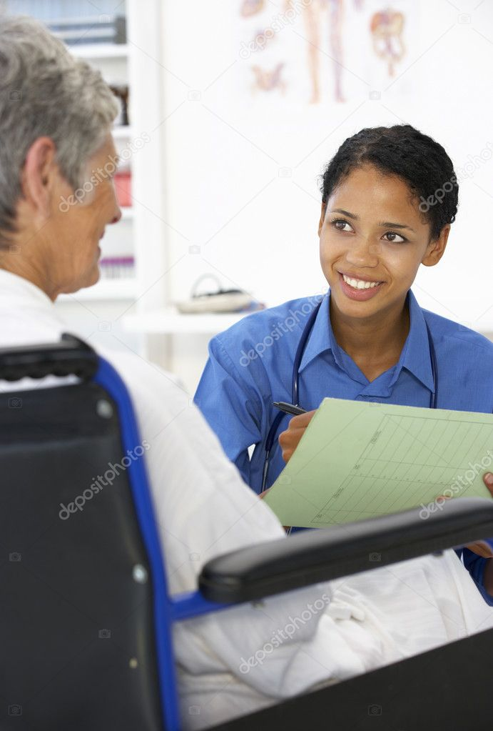 Doctor with female patient  Stock Photo #11882362