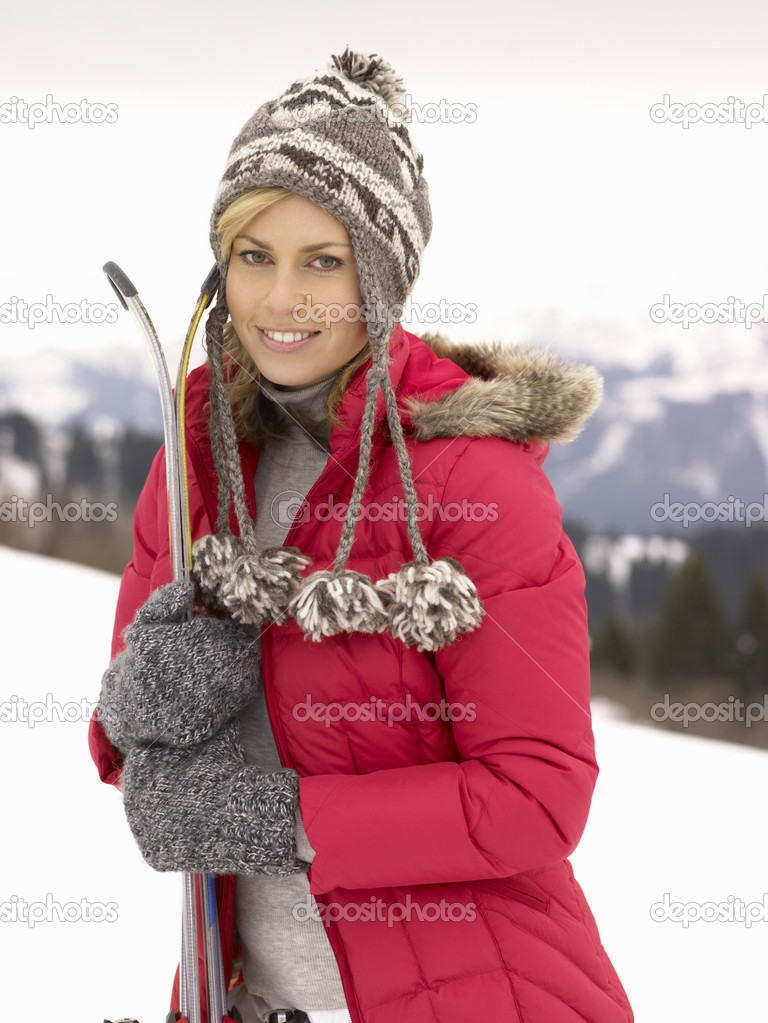 Young Woman holding Skis In Alpine Landscape — Stok fotoğraf #11882691