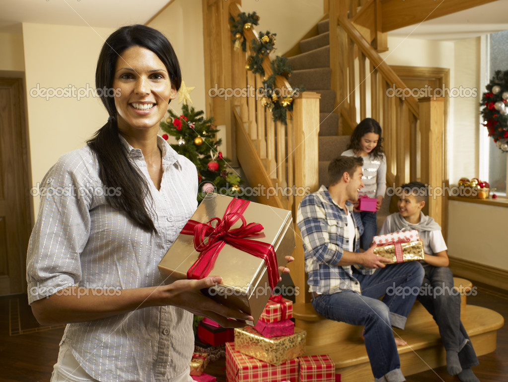 Hispanic family exchanging gifts at Christmas  Stock Photo #11882878