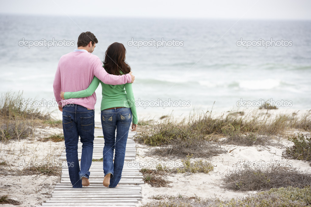 Couple walking by the sea  Stock Photo #11883707